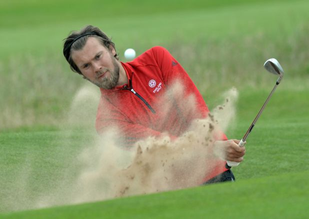 Dan Brown (England) bunkered at the 18th green on the first day of the 2015 Home International Matches at Royal Portrush Golf Club. Picture by  Pat Cashman