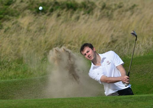 Ashley Chesters (England) bunkered at the the 11th green during the second day of the 2015 Home International Matches at Royal Portrush Golf Club. Picture by Pat Cashman