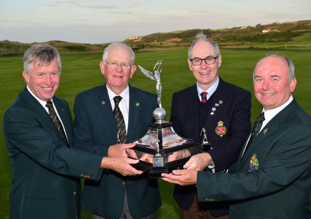Sir Richard McLaughlin (Captain, Royal Portrush Golf Club) presenting Tony Goode (Team Captain) with the Raymond Trophy (Home International Trophy) after Ireland's victory at Royal Portrush Golf Club today (14/08/2015). Also in the picture are John White (Team Manager) and Michael Connaughton (President, GUI). Picture by Pat Cashman