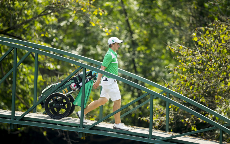 Paul Dunne walks across the bridge on the third hole of the North Course at Olympia Fields during his first round Monday. The 54-hole co-leader at the Open Championship shot a 1-over 71. (USGA/John Mummert)
