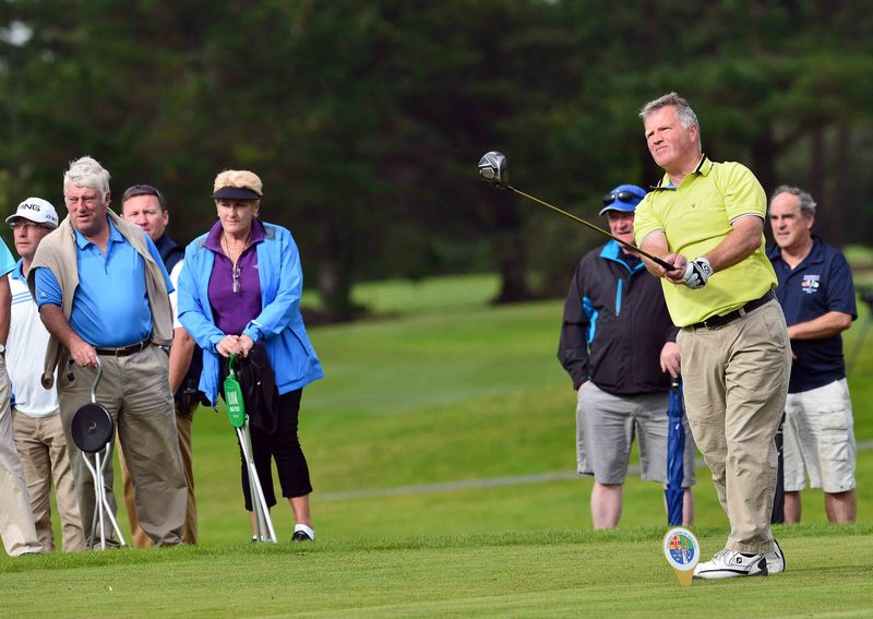 Eddie Power (Kilkenny) watched by Mick Burns (Walker Cup selector) driving at the 17th at Tramore Golf Club (19/05/2015). Picture by  Pat Cashman