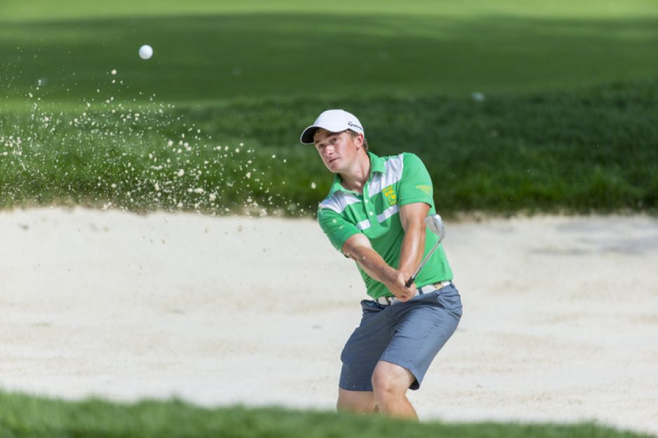 Paul Dunne blasts out of a bunker on the 15th hole during the first round of match play of the 2015 U.S. Amateur at Olympia Fields Country Club in Olympia Fields, Ill. on Wednesday, Aug. 19, 2015.  (Copyright USGA/Jeff Haynes)