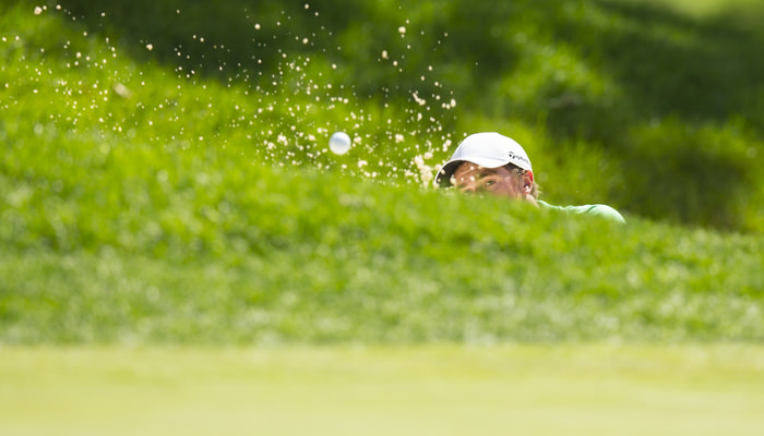 Paul Dunne blasts out of a greenside bunker on the fifth hole during the third round of match play of the 2015 U.S. Amateur at Olympia Fields Country Club in Olympia Fields, Ill. on Thursday, Aug. 20, 2015.  (Copyright USGA/John Mummert)