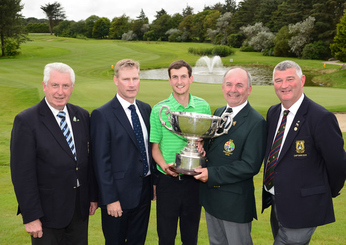 Michael Connaughton (President, GUI) presenting Tiarnan McLarnon (Massereene) with the 2015 AIG Irish Amateur Close Championship trophy after his victory at Tramore Golf Club (22/05/2015). Also in the picture are John Molloughney (Chairman, Munster Branch), Aidan Connaughton (AIG) and David Jackman (Captain, Tramore Golf Club). Picture by  Pat Cashman