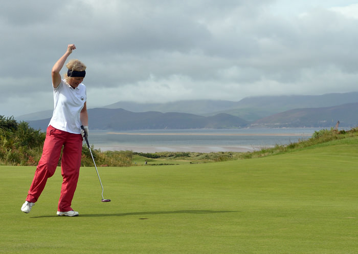 Eileen Breen (Dooks) holes the winning putt on the 18th green to clinch the 2015 Irish Mixed Foursomes Final (sponsored by the Spanish Tourist Board) at Dooks Golf Club today (04/09/2015).  Picture: Pat Cashman