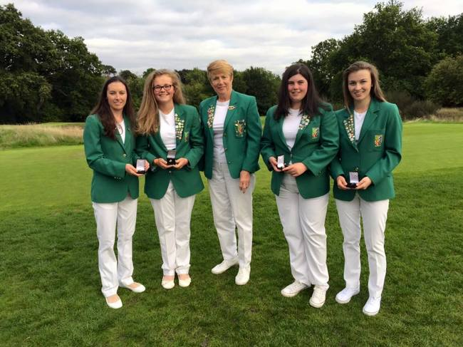 New caps (left to right) Sarah Helly (Enniscrone), Annabel Wilson (Lurgan), Niamh McSherry (Lurgan) and Julie McCarthy (Forrest Little) with ILGU President Valerie Hassett (centre) at Royal Wimbledon.