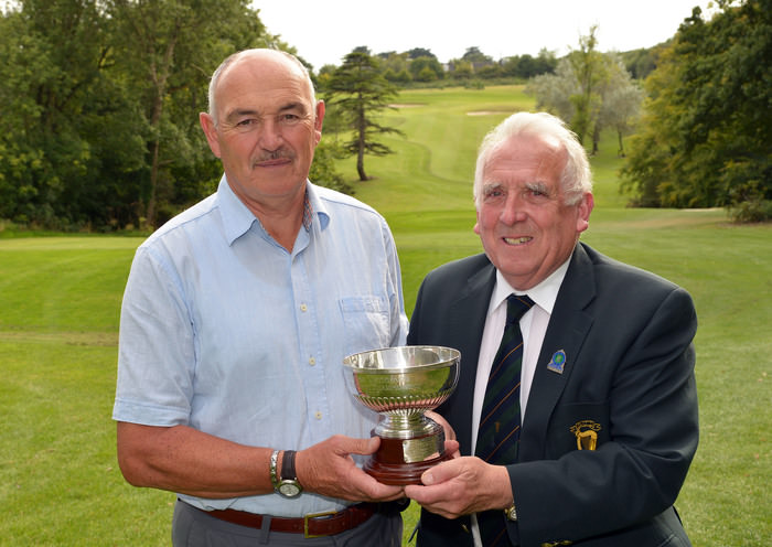 John Ferriter (Chairman, Leinster Golf, GUI) presenting Billy Donlon (Birr) with the 2015 Leinster Veterans Amateur Open Championship trophy after his victory at Seafield Golf Club. Picture by  Pat Cashman