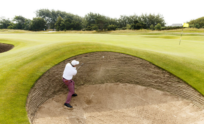 Denny McCarthy blasts out of a greenside bunker on the sixth hole during a practice round ahead of the 2015 Walker Cup at Royal Lytham & St. Annes G.C. in Lytham St Annes, Lancashire on Friday, Sept. 11, 2015.  (Copyright USGA/John Mummert)