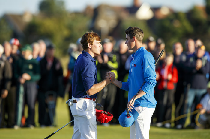 Robby Shelton, left, shakes hands with Gary Hurley, right, on the 18th hole during an afternoon singles match at the 2015 Walker Cup at Royal Lytham & St. Annes G.C. in Lytham St Annes, Lancashire on Saturday, Sept. 12, 2015.  (Copyright USGA/John Mummert)