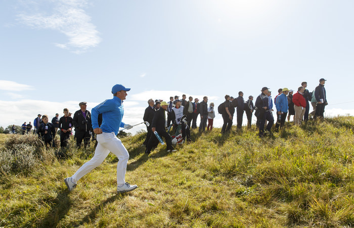 Paul Dunne runs up after playing his third shot on the fourth hole during an afternoon singles match at the 2015 Walker Cup at Royal Lytham & St. Annes G.C. in Lytham St Annes, Lancashire on Saturday, Sept. 12, 2015.  (Copyright USGA/John Mummert)