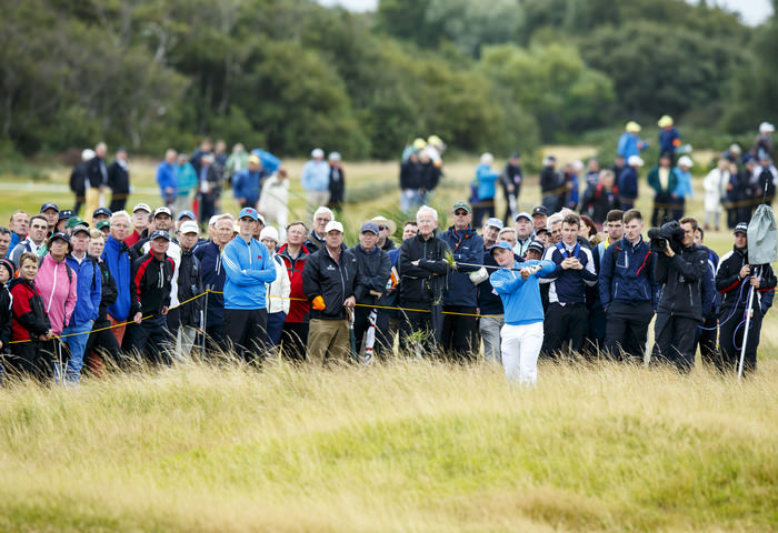 Paul Dunne watches his second shot on the 14th hole during the morning foursomes matches of the 2015 Walker Cup at Royal Lytham & St. Annes G.C. in Lytham St Annes, Lancashire on Saturday, Sept. 12, 2015.  (Copyright USGA/John Mummert)