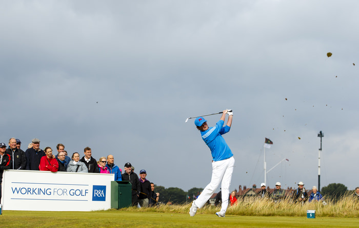 Cormac Sharvin watches his tee shot on the fifth hole during the morning foursomes matches of the 2015 Walker Cup at Royal Lytham & St. Annes G.C. in Lytham St Annes, Lancashire on Saturday, Sept. 12, 2015.  (Copyright USGA/Chris Keane)