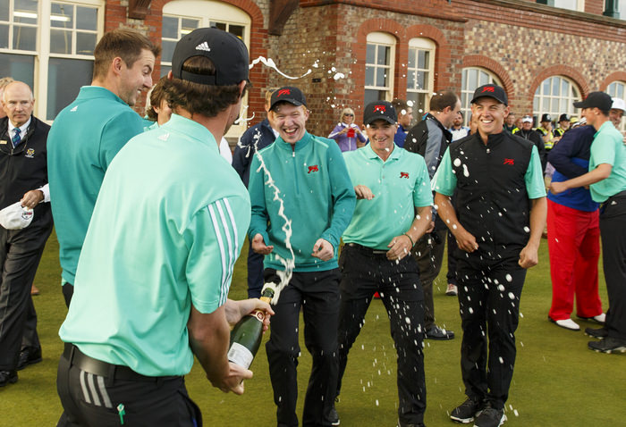 Cormac Sharvin sprays other GB&I players with champagne after winning x during an afternoon singles match at the 2015 Walker Cup at Royal Lytham & St. Annes G.C. in Lytham St Annes, Lancashire on Sunday, Sept. 13, 2015.  (Copyright USGA/John Mummert)