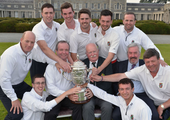 Castletroy member Liam Martin (President, Golfing Union of Ireland) presenting the AIG Junior Cup to John McDonnell (Team Captain) after Castletroy's victory at Carton House in 2014. Also in the picture are (clockwise) Keith Bermigham, Michael Murphy, Colm Geary, David Charlton, Brendan Reidy, John Kavanagh, Cillian O'Muineachain, Diarmuid Leonard, Simon Russell (AIG) and Jonathan McDonnell. Picture by Pat Cashman