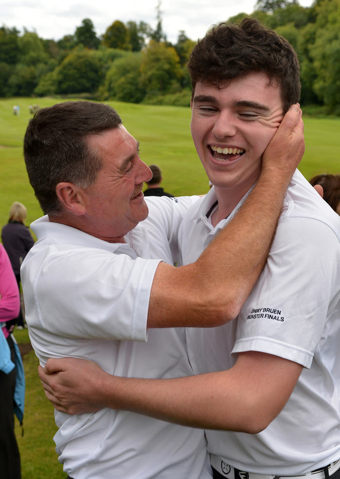 Ronan Cross (Ballybunion) is congratulated by Paul Enright after victory on the 16th green the AIG Jimmy Bruen Shield Final. Picture by  Pat Cashman