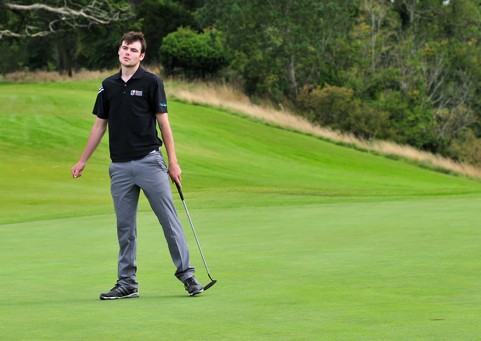 Jake Whelan (Maynooth) holes the winning putt on the 18th green in the AIG Senior Cup Final at Carton House Golf Club. Picture by  Pat Cashman