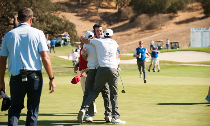 Niall Kearney is mobbed by his team mates on the 18th. Picture © Montana Pritchard/The PGA of America