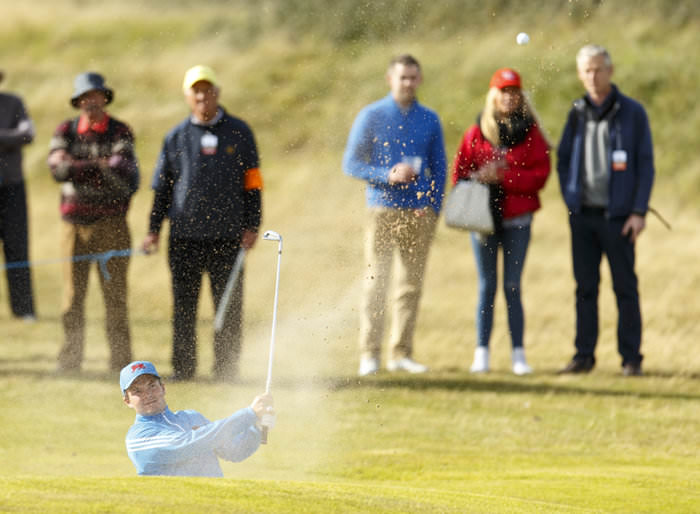 Jack Hume blasts out of a bunker on the seventh hole during an afternoon singles match at the 2015 Walker Cup at Royal Lytham & St. Annes.  (Copyright USGA/Chris Keane)