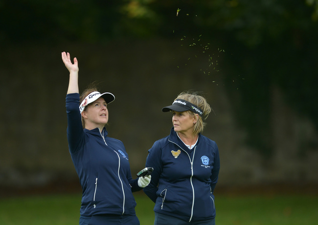Andrea Watson and Leonie Power (Rockmount) checking the wind at the 13th hole in the 2015 Miele All Ireland Fourball Final at Newlands. Picture by  Pat Cashman