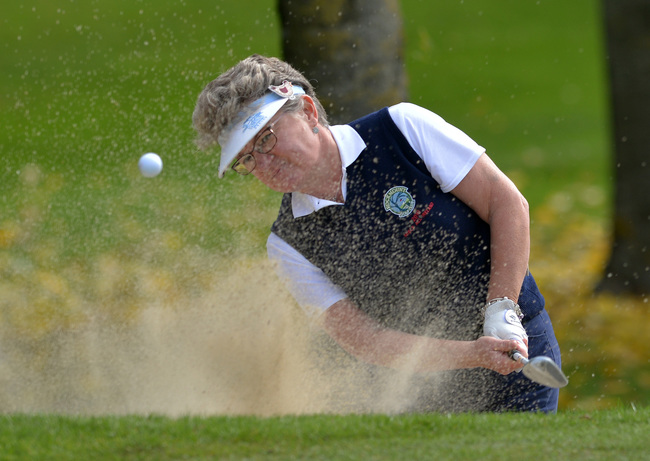 Maureen Entwistle (Rockmount) bunkered at the 7th green in the 2015 Miele All Ireland Fourball Final at Newlands Golf Club today (04/10/2015). Picture by Pat Cashman