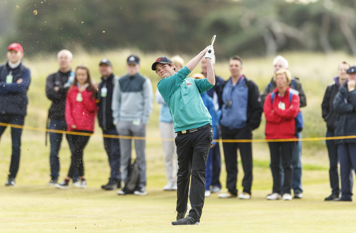 Cormac Sharvin watches his second shot on the fourth hole during a morning foursomes match at the 2015 Walker Cup at Royal Lytham & St. Annes G.C. in Lytham St Annes, Lancashire on Sunday, Sept. 13, 2015.  (Copyright USGA/Chris Keane)