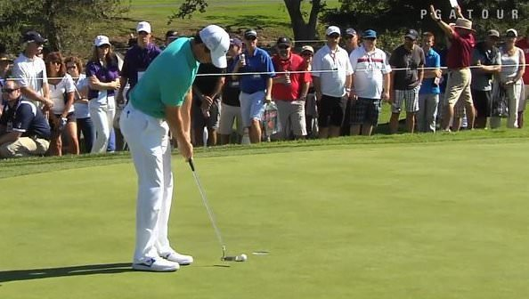 Rory McIlroy taps in a par putt in California last night