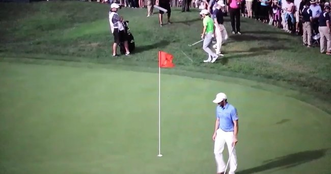 Grill's ball can be seen between the top of the flag and McIlroy