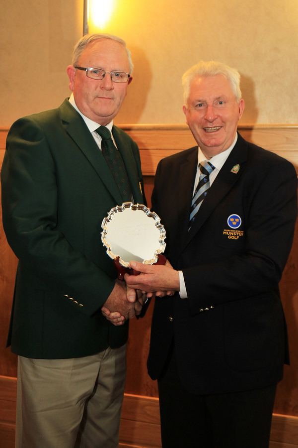 Dooks Golf Club Captain Willie Murphy accepting the Munster Team of the Year award from Mr John Moloughney, Chairman Munster Branch GUI.  The Mixed Foursomes team from Dooks won the award after winning the All-Ireland title for the first time. Picture: Niall O'Shea