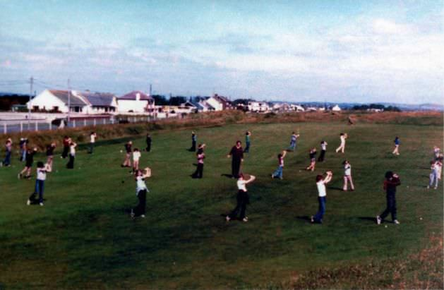 SATURDAY MORNING LESSONS ON THE 18TH FAIRWAY WITH BOBBY CONDUCTING AFFAIRS FROM THE CENTRE WAS A FAMILIAR SCENE AT LAYTOWN AND BETTYSTOWN.