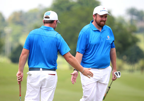 Shane Lowry of Ireland and Andy Sullivan of England celebrate during their foursomes win over Prayad Marksaeng and Shingo Katayama. PIcture: Mark Dadswell/Asian Tour