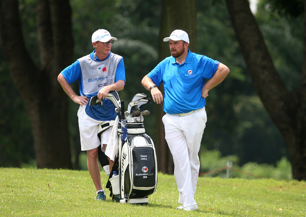 Shane Lowry and caddie Dermot Byrne. PIcture: Mark Dadswell/Asian Tour