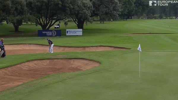 Paul Dunne prepares to execute a tricky flop shot during his third round
