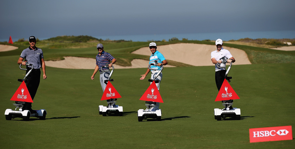 Henrik Stenson, Jordan Spieth, Rickie Fowler  and Rory McIlroy ride golf boards at Saadiyat Beach Golf Club prior to the 2016 Abu Dhabi HSBC Golf Championship. Photo by Matthew Lewis/Getty Images