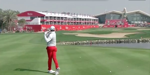 Rory McIlroy hits to the 18th