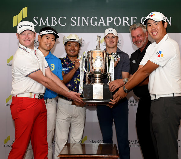 SINGAPORE-L-R- Jamie Donaldson of Wales, Y E Yang of Korea, Shingo Katayama of Japan, Jordan Spieth of the USA, Darren Clarke of Northern Ireland, An Byeong-hun of Korea pictured with the trophy Tuesday January 26, 2016, ahead of the SMBC Singapore Open at the Sentosa Golf Club, Serapong Course, Singapore. Picture by Paul Lakatos / Lagardère Sports.