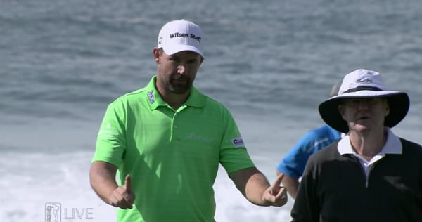 Padraig Harrington reads a putt for JP McManus at Pebble Beach