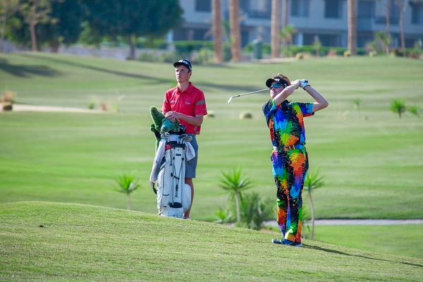 The colourfully attired David Carey with pal Darragh Flynn on the bag in Egypt.