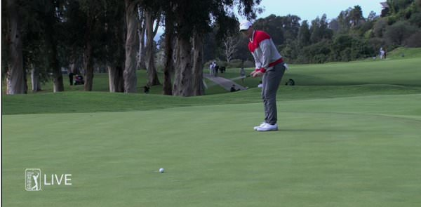 Rory McIlroy shaves the holes with a 20 footer for birdie at the 18th, his ninth