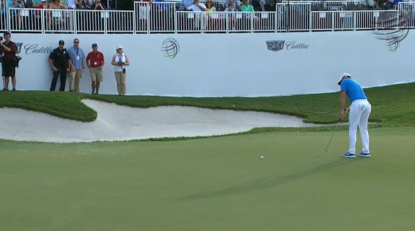 Rory McIlroy makes his eighth birdie of the day at the 18th