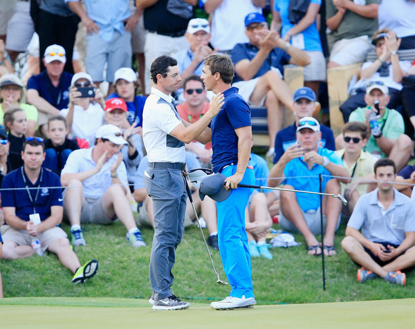What just happened? Rory McIlroy consoles Thorbjorn Olesen after snatching a 1-up win on the 18th in Austin. it was the first time he'd been up in the match all day. Picture: Getty Images