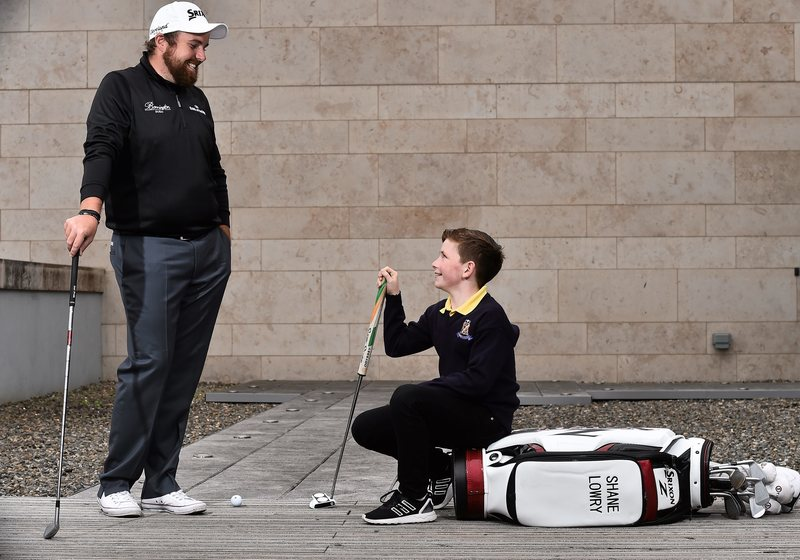 Shane Lowry with Eoin Duffy, age 10, from Forrest Little at the Bank of Ireland Irish Open sponsorship launch, Bank of Ireland Offices, Burlington Plaza, Dublin. Picture credit: David Maher / SPORTSFILE