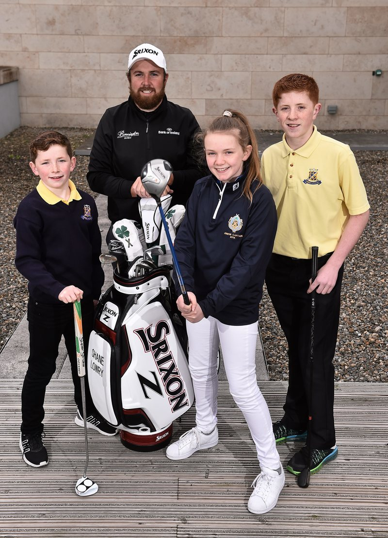 Shane Lowry with Eoin Duffy, age 10, left, and his brother Dean, age 15, both from Forrest Little golf club, Swords, Co. Dublin, and Julie Moran, age 13, from Castle Golf Club, Rathfarnham, Co. Dublin.Picture credit: David Maher / SPORTSFILE