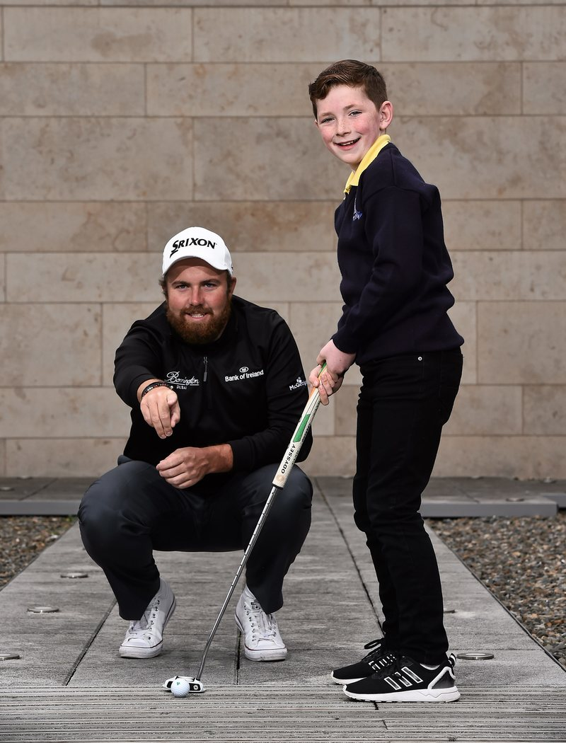 8 March 2016; Golfer Shane Lowry with Eoin Duffy, age 10, from Forrest Little golf club, Swords, Co. Dublin. Bank of Ireland Irish Open Sponsorship Launch, Bank of Ireland Offices, Burlington Plaza, Dublin. Picture credit: David Maher / SPORTSFILE
