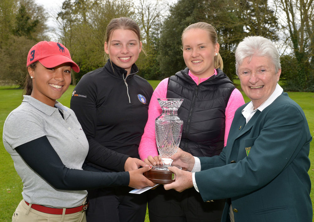 Irene Poynton (Board Member ILGU) presenting the Swedish C team of Louise Henningsson, Ellen Hutchinson-Kay and Matilde Stenqvist with the Nations Cup at Roganstown. Picture by  Pat Cashman