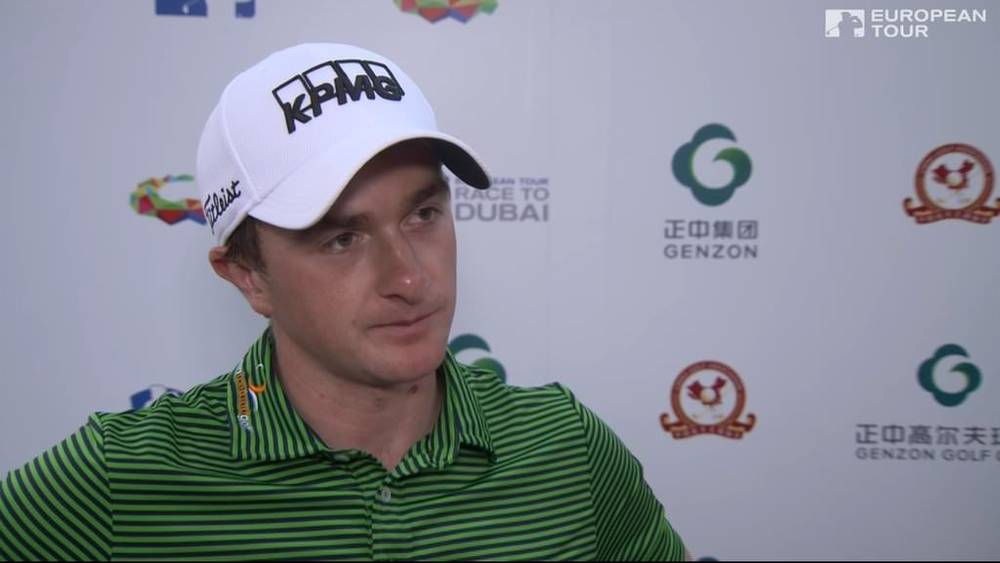 Paul Dunne speaks to the media after his 69