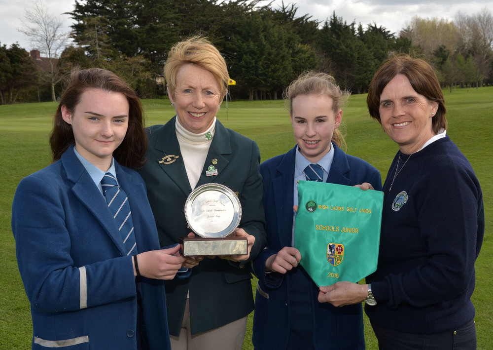 Valerie Hassett (President, ILGU) presenting Ciara Brennan and Olivia McCrystal (Rathmore Grammar College, Belfast) with the Junior Cup after their victory at Milltown Golf Club. Also in the picture is Ciara Agnew (Teacher). Picture by Pat Cashman