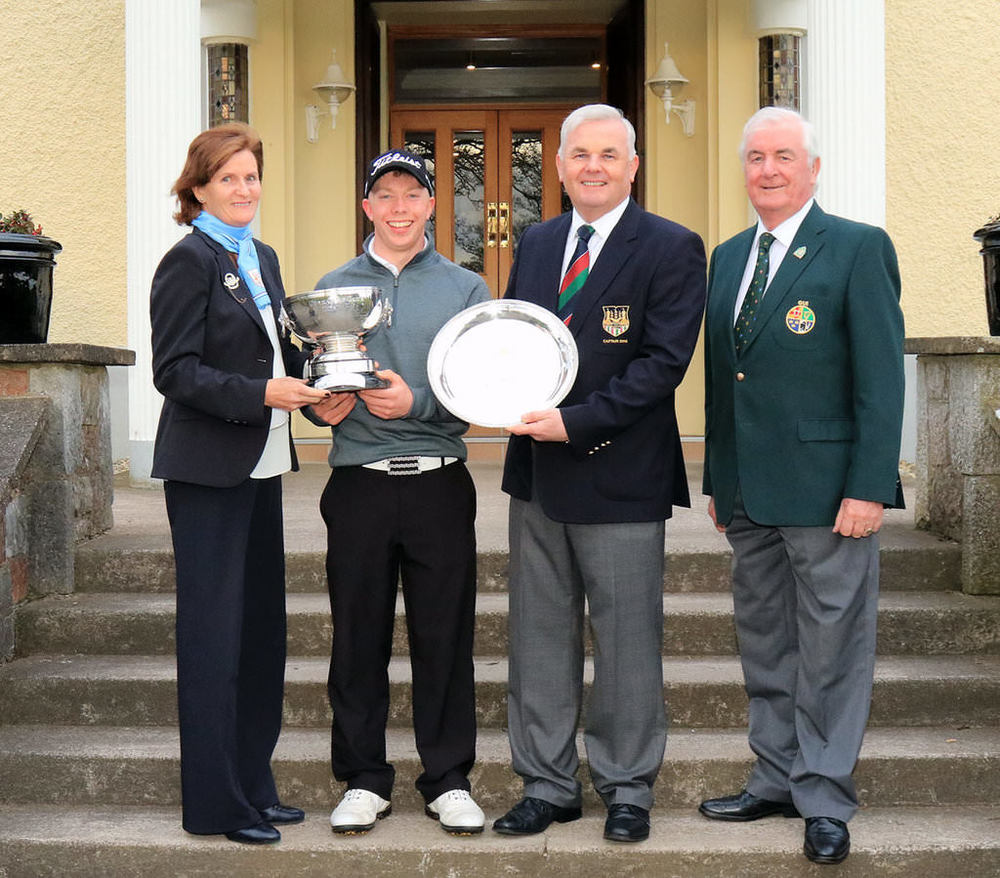 Cork GC Lady Captain Maeve Hickey presents Cathal Butler (Kinsale) with the Munster Strokeplay Championship, also included are Damien Wallace, Captain Cork GC and Liam Harkin, Munster Golf.Picture: Niall O'Shea. Courtesy Munster Golf/Cork Golf Club