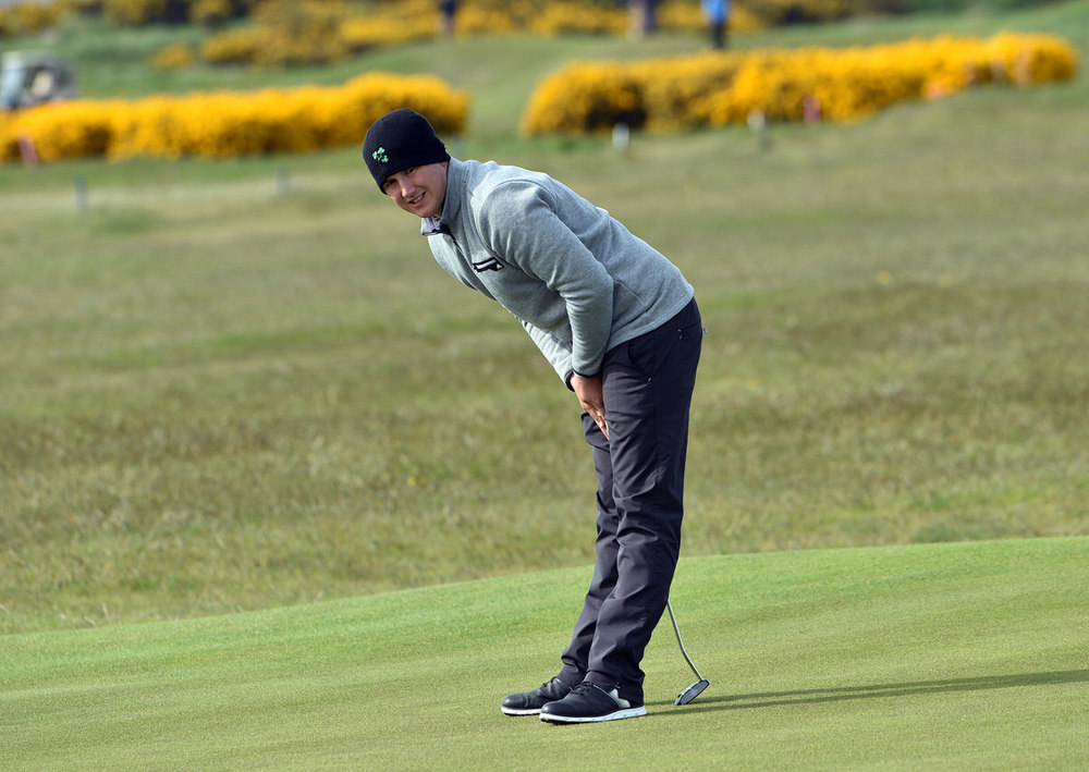 Leader Colm Campbell Jnr (Warrenpoint) reacts to his birdie putt on the 18th green in the second round of the 2016 Flogas Irish Amateur Open Championship at The Royal Dublin Golf Club. Picture by Pat Cashman