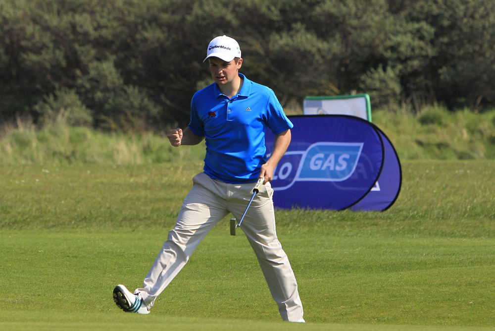Jack Hume (Naas) sinks a 60 foot putt on the 18th in the final round of the Flogas Irish Amateur Open Championship at Royal Dublin on Sunday. Picture: Thos Caffrey / www.golffile.ie