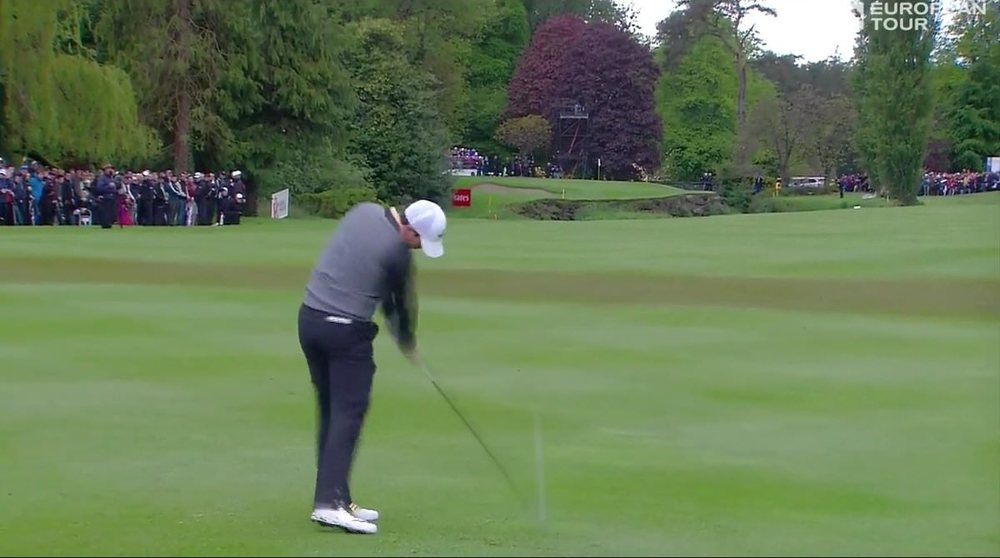 Rory McIlroy stripes his three wood to the heart of the 16th green